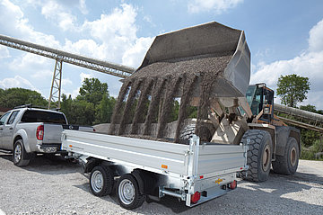 HTK Aluminium heavy-duty tipper trailer being loaded with gravel